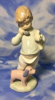 """Nao by Lladro """"Boy on Phone with Puppets"""" Glazed Porcelain Figurine #1044 EUC"""