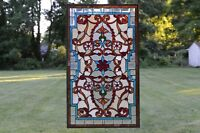 "20.5""W x 34.5""H Handcrafted Jeweled stained glass window panel."