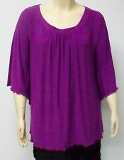 YOEK,THEIR SIZE MEDIUM,PURPLE POLYESTER JERSEY TUNIC, WITH RUFFLED SLEEVES.