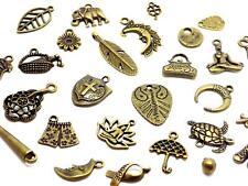 58 breloques décorées bronze assortiment et différentes dimensions