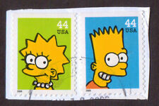 USA 2009 Bart and Lisa Simpson 44c stamps x 2 used on small piece.