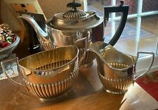 THREE PIECE EDWARDIAN HALF GADROONED SILVER PLATED TEASET