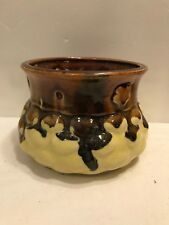 POTTERY POT WITH BROWN DRIPPING TO YELLOW GLAZES AND HOLES FOR HANGING