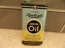 Vintage 8 Oz. RAWLEIGH'S IDEAL OIL, empty. 5 1/4 in.tall, photos show conditions