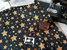 50cm Gold Sparkle Stars print cotton lycra 4 way stretch knit fabric 150cm wide
