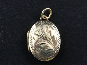 Vintage pretty rolled gold engraved oval locket