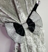 Bow curtain tie backs. Black crushed velvet . Silver glitter.  One pair. Glitz..