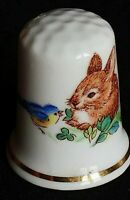 BABY RABBIT AND TWEETY BIRD SHARING DINNER ILLUSTRATED CHINA SOUVENIR THIMBLE