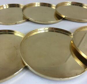 Stelton brass glascoasters by Arne Jacobsen (6)