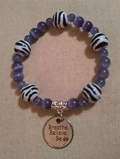 Periwinkle and Zebra Beads Bracelet with a Breathe Believe Be Dandelion Charm.