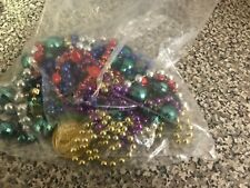 Bag of Mardi Grass Beads and Doblooms
