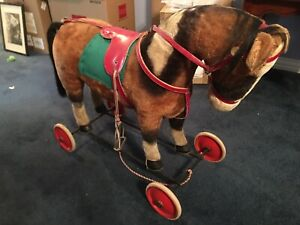 VINTAGE STEIFF RIDE ON MOHAIR HORSE with WHEELS - appears complete