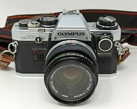 Olympus OM10 macchina fotografica con ottica 50 mm e manual adapter olympus