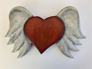 Hand carved wooden heart with wings