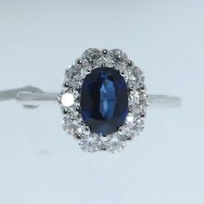 18ct WHITE GOLD OVAL CUT 1.20 CARAT BLUE SAPPHIRE AND DIAMOND HALO RING
