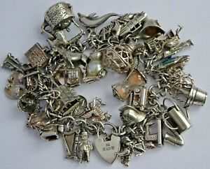 Amazing vintage solid silver charm bracelet & 40 charms,rare,open,move. 107.5g