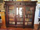 R.J. HORNER  19 C.CARVED FIGURAL 3 DOOR BOOKCASE