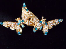 Unusual little gold coloured double butterfly brooch with little stones