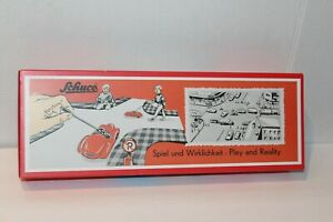 VERY NICE SCHUCO #4526 PLAY SET  in BOX with TWO #4521 CARS