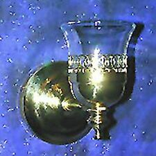 Brass sconce with oyster style votive cup