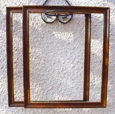 DEUX CADRES EN BOIS LAQUE LISTON DORE 54 x 45.