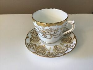 Gilman & Collamore co. Fifth Ave., New York White &gold cup & saucer coalport