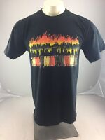 Vintage City skyline on fire patched black T-shirt size large USA made casual