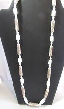 VINTAGE WHITE TUBE SHAPE PLASTIC BEADED NECKLACE WITH BROWN FLOWER DESIGN