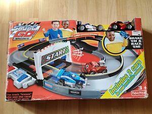 Fisher Price Shake N Go Speedway NEW  in unopened box. SHAKE 'EM & RACE 'EM