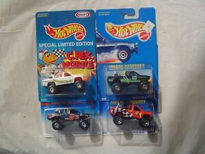 HOTWHEELS = LOT OF 4 = NISSAN HARDBODY TRUCK = IN DIFFERENT COLORS