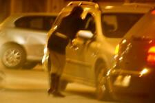 Photo.  2000s.  Prostitute talking business