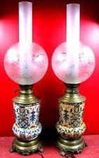 ancienne fausse paire lde lampes à huile en faience de Gien?