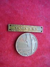 A VINTAGE SMALL METAL PLAQUE '1st ARMY'