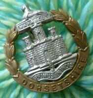Dorsetshire Regiment Cap Badge Bi-Metal Slider ANTIQUE Original maker GLADMAN &.