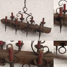 lustre  rustique fonte de fer bras en bois huit bras de lumière  . XX siècle .