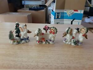 CHRISTMAS FIGURINE LOT OF 3 CHILDREN PLAYING IN THE SNOW