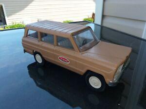 tonka stamped steel jeep wagoneer tan