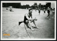 strong man in swimsuit w suitcase and chain, funny, unusual,  Vintage Photograph