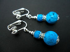 A PAIR OF TURQUOISE GLASS  SILVER  PLATED DROP DANGLY CLIP ON  EARRINGS. NEW.