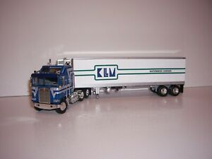 DCP FIRST GEAR 1/64 KLLM KENWORTH K100 WITH SLEEPER CAB AND REEFER VAN TRAILER