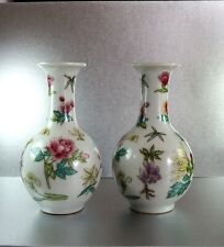 A pair of vintage early 1900 Chinese Famille Rose hand painted porcelain vases