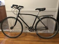 Black 3-speed vintage Rudge w curved top tube. Looks and rides great