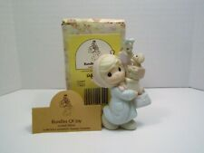 """Precious Moments ornament """"Bundles of Joy """" # 525057 Girl w/ packages"""
