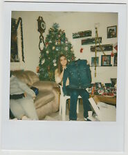 Found Polaroid PHOTO Young Woman Girl Holding Up Christmas Gift Jean Jacket