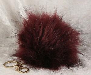 Deep purple fluffy pom pom keyring in good condition