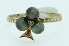 An Unusual Shamrock Cabochon Chrysoberyl Cats Eye & Diamond Ring