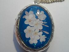 SILVER PLATED LOCKET-DEEP BLUE WITH WHITE FLOWER