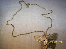 Joli collier ancien représentant un papillon et sa chaine à maillons. N°18