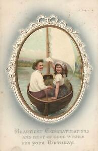 VINTAGE EMBOSSED YOUNG LOVERS in BOAT HAPPY BIRTHDAY POSTCARD sent to Leeds UK