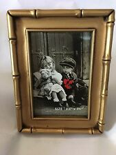 "Gold "" Bamboo "" Small Frame . Holds a photo aprox. 2.5.x 3.5 . Item # 1034"